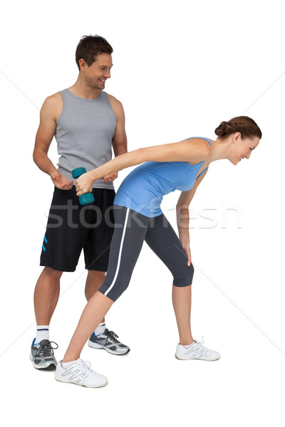 Male trainer assisting woman with dumbbell Stock photo © wavebreak_media