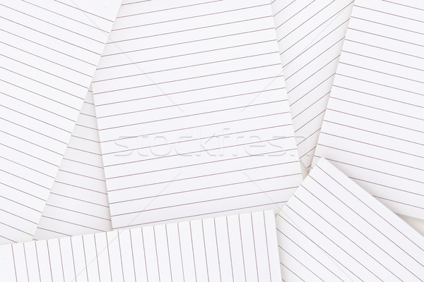 Lined paper strewn over surface Stock photo © wavebreak_media