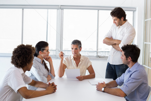 Serious businesswoman speaking to her coworkers Stock photo © wavebreak_media