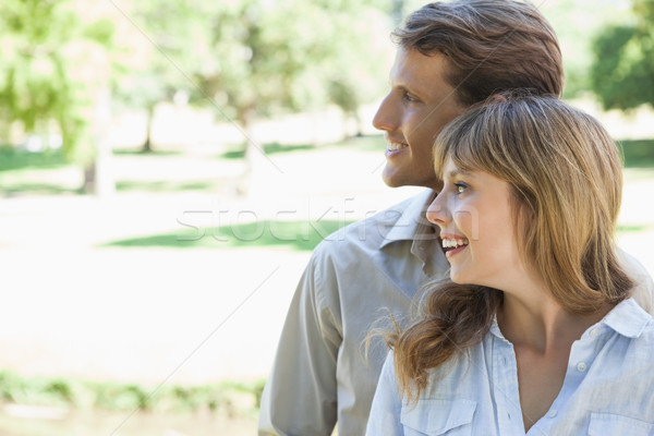 Carefree couple standing in the park and smiling  Stock photo © wavebreak_media