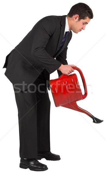 üzletember locsol piros konzerv fehér férfi Stock fotó © wavebreak_media