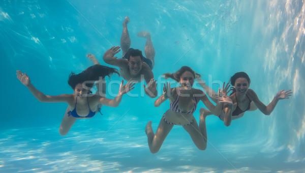 Gülen arkadaşlar bakıyor kamera sualtı yüzme havuzu Stok fotoğraf © wavebreak_media