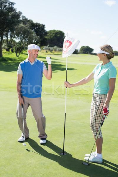 Dame golfer gat vlag juichen Stockfoto © wavebreak_media