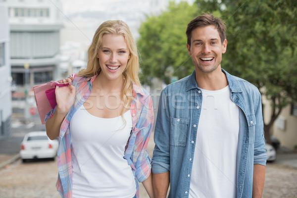 Hip young couple on shopping trip walking uphill Stock photo © wavebreak_media