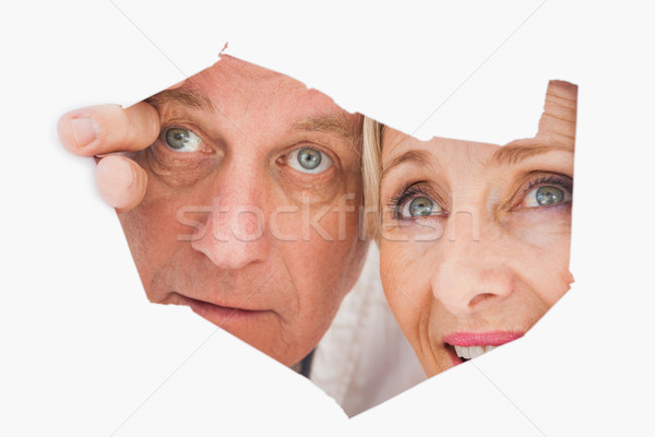 Older couple looking through rip Stock photo © wavebreak_media