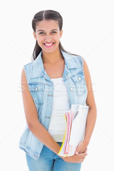 Csinos diák mosolyog tart notebook portré Stock fotó © wavebreak_media