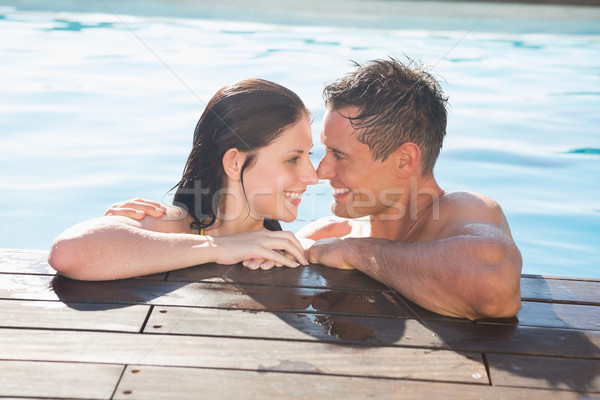 Couple in swimming pool on a sunny day Stock photo © wavebreak_media