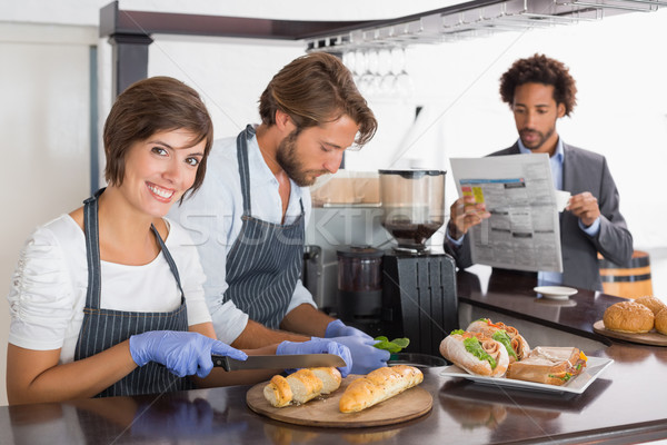 Feliz servidores sanduíches juntos café negócio Foto stock © wavebreak_media