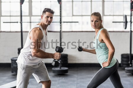 Personal trainer working with client on exercise mat Stock photo © wavebreak_media