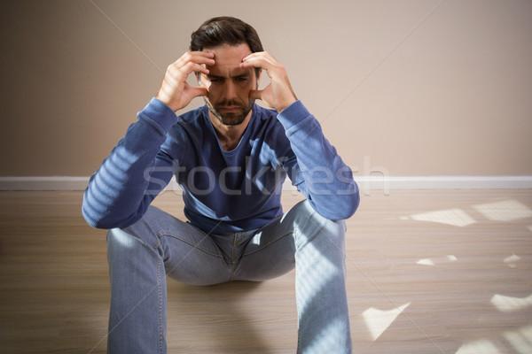 Depressed man sitting on floor Stock photo © wavebreak_media