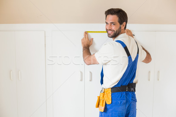 Handyman measuring a wardrobe Stock photo © wavebreak_media