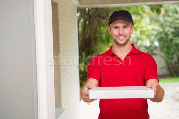 Pizza delivery man delivering pizzas Stock photo © wavebreak_media