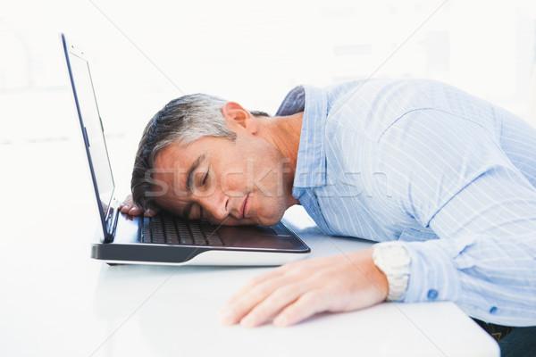 Man with grey hair sleeping on his laptop Stock photo © wavebreak_media