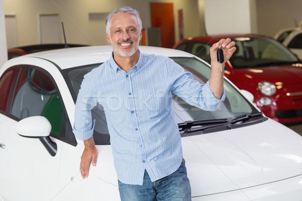 Customer standing while holding car key Stock photo © wavebreak_media
