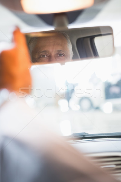 Businessman looking in an interior car mirror Stock photo © wavebreak_media
