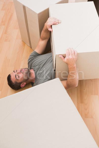 Férfi alszik költözködő dobozok otthon nappali ingatlan Stock fotó © wavebreak_media