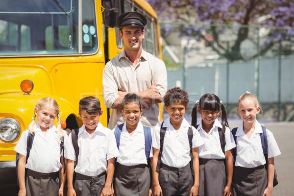 Aranyos iskolás iskolabusz sofőr kívül általános iskola Stock fotó © wavebreak_media