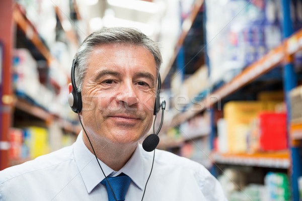 Warehouse manager giving orders on headset Stock photo © wavebreak_media