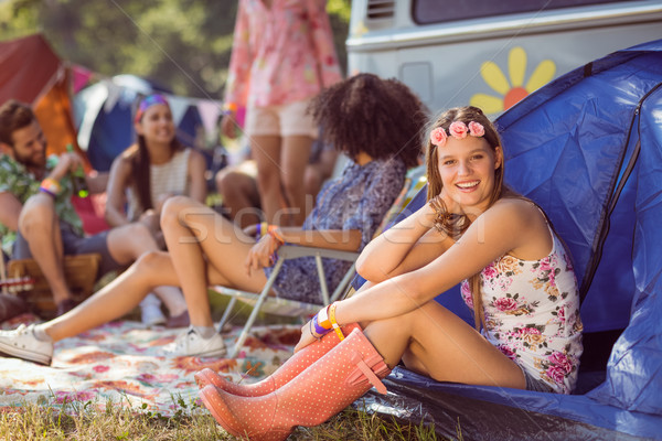 Carefree hipster smiling on campsite Stock photo © wavebreak_media
