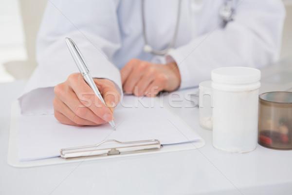 Vet writing on clipboard the prescriptions Stock photo © wavebreak_media