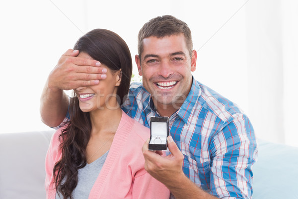 Happy man covering womans eyes while gifting ring Stock photo © wavebreak_media