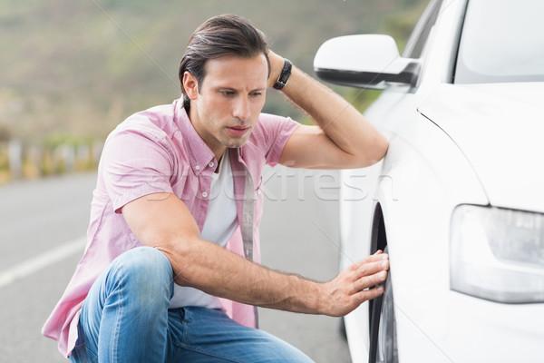Stressed man looking at wheel  Stock photo © wavebreak_media
