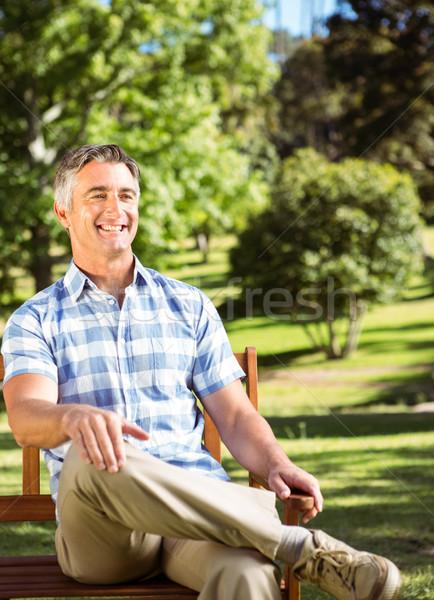 Lezser férfi megnyugtató park pad napos idő Stock fotó © wavebreak_media