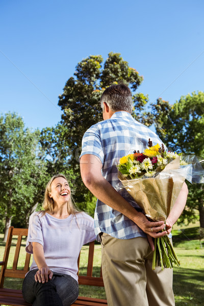 Man surprising his girlfriend with a bouquet in the park Stock photo © wavebreak_media