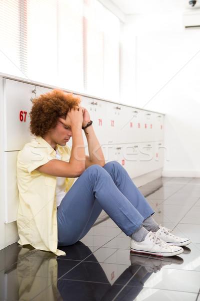 Tensed young man in office corridor Stock photo © wavebreak_media