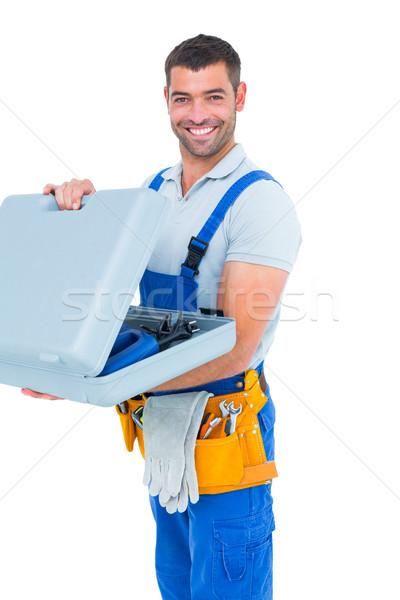 Portrait of happy repairman opening toolbox Stock photo © wavebreak_media