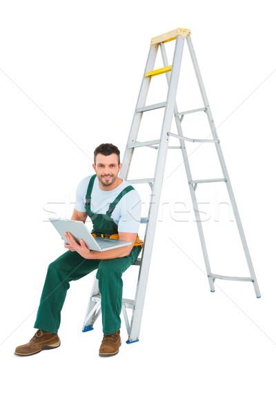 Carpenter sitting on ladder using laptop  Stock photo © wavebreak_media