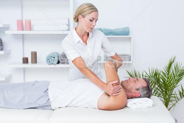 Arts onderzoeken patiënt arm medische kantoor Stockfoto © wavebreak_media