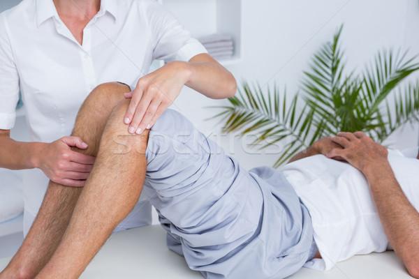 Man knie massage medische kantoor vrouw Stockfoto © wavebreak_media