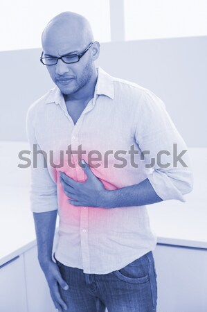 Businessman with a painful headache Stock photo © wavebreak_media