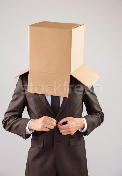 Anonim üzletember kabát szürke férfi doboz Stock fotó © wavebreak_media