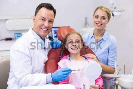 Foto stock: Dentista · examinar · ninas · dientes · ayudante · dentistas