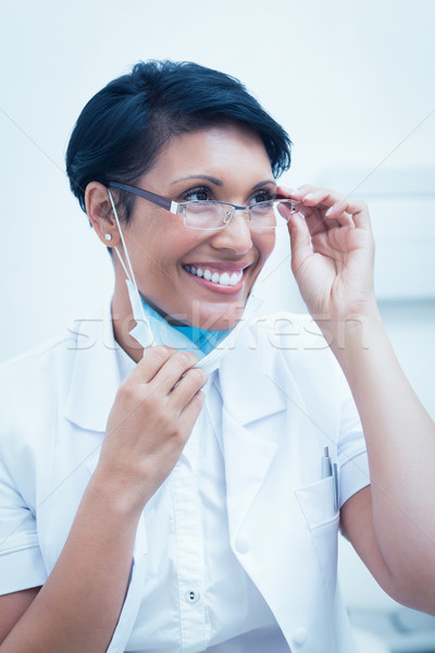 Vrouwelijke tandarts glimlachend portret bril baan Stockfoto © wavebreak_media