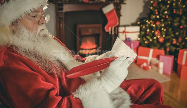 Дед Мороз Дать список выделите домой гостиной Сток-фото © wavebreak_media