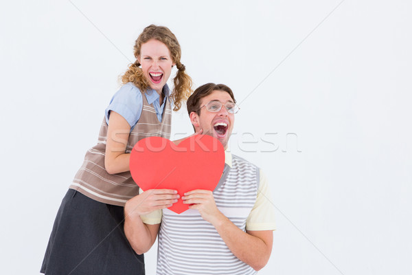 Excited geeky hipster couple with heart card  Stock photo © wavebreak_media
