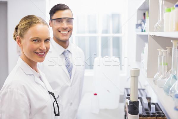 Sorridente cientistas olhando câmera laboratório mulher Foto stock © wavebreak_media
