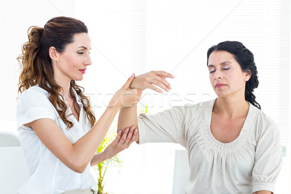 Therapist holding her patients arm Stock photo © wavebreak_media