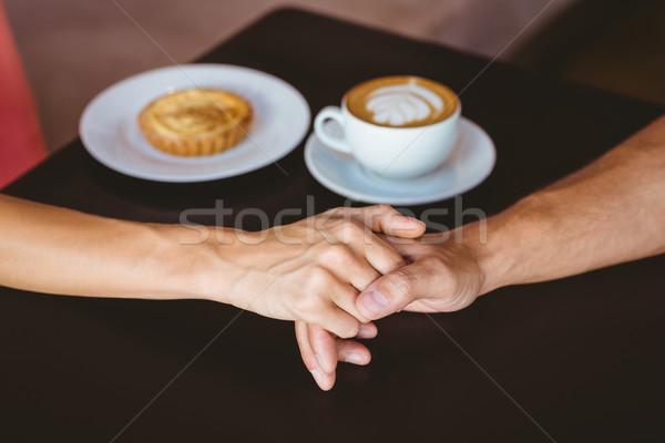 Cute Coppia data holding hands cafe uomo Foto d'archivio © wavebreak_media