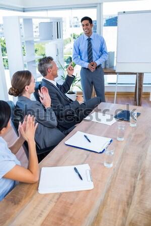 Uomini d'affari parlando riunione ufficio business donna Foto d'archivio © wavebreak_media