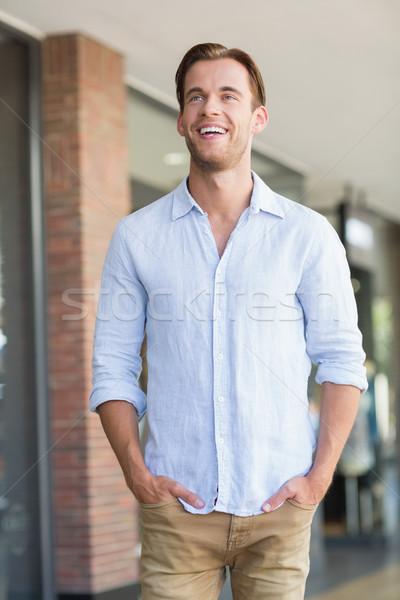 Feliz sorridente homem mãos bolso shopping Foto stock © wavebreak_media