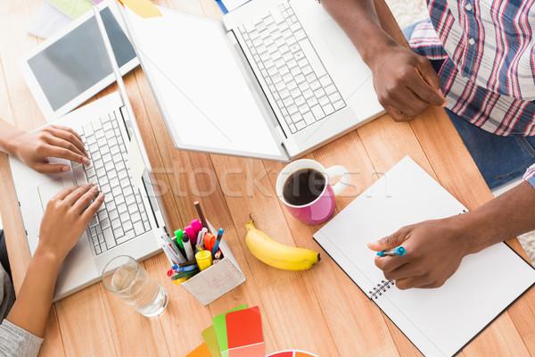 Jungen Geschäftsleute arbeiten Laptops Büro Computer Stock foto © wavebreak_media