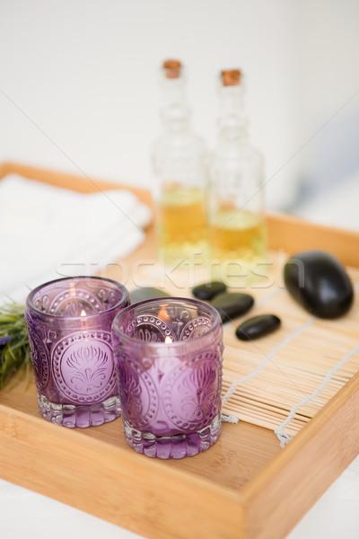Massagem bandeja velas pedras óculos Foto stock © wavebreak_media