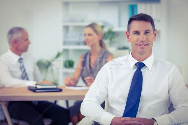 счастливым бизнесмен улыбаясь камеры коллеги за Сток-фото © wavebreak_media