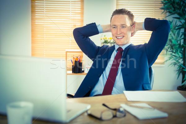 Entspannt Geschäftsmann Sitzung zurück Schreibtisch Büro Stock foto © wavebreak_media