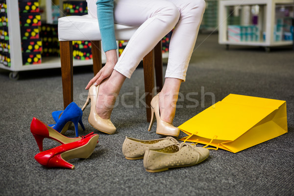 Woman trying on different shoes Stock photo © wavebreak_media