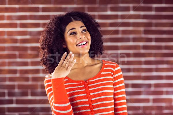 驚いた 魅力的な 若い女性 赤 レンガ ファッション ストックフォト © wavebreak_media